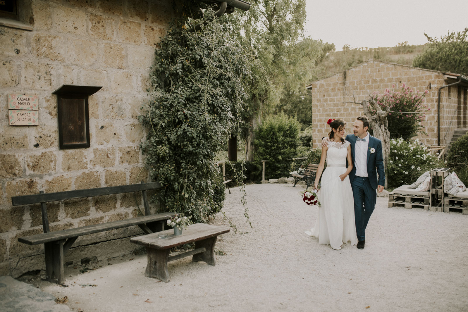 Bride and groom walk around the outside of the Villa in Italy by Michele Abriola