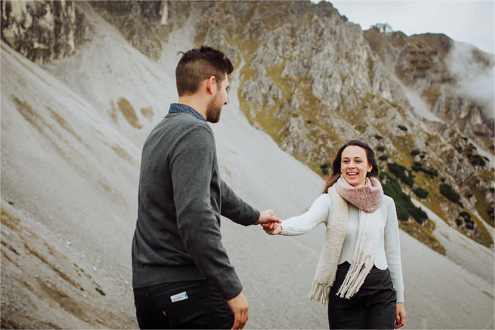 A couple walks hand in hand on the Nordkette mountain in Innsbruck by Wild Connections Photography